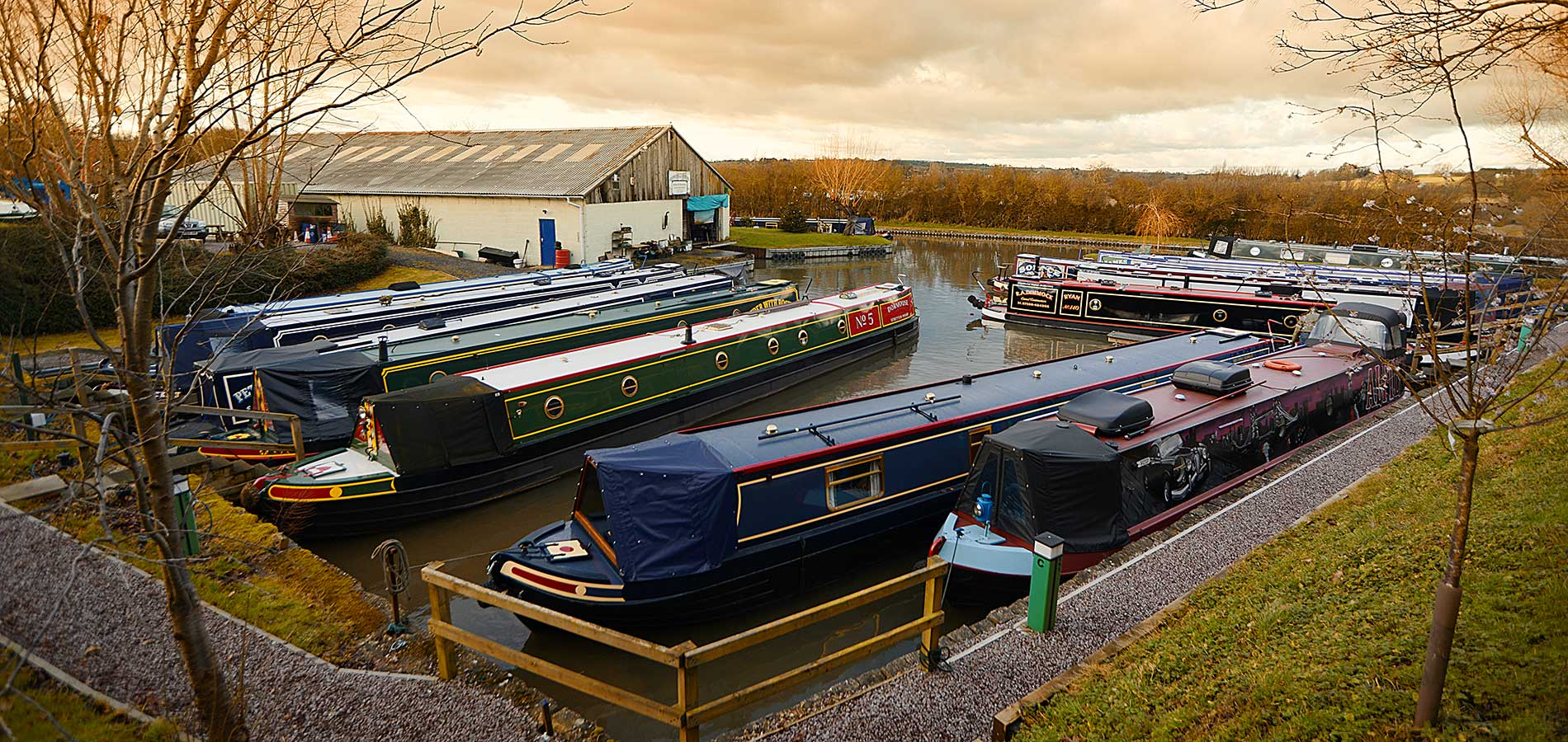 Boats moored at Stowe Hill Wharf, Rugby Boat Sales